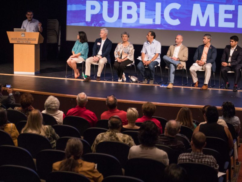 (From left) Mike Flores, Palo Alto College President, speaks on stage next to Mayor's Housing Policy Task Force Members Lourdes Castro Ramirez, Gene Dawson, María Berriozábal, Noah Garcia, Jim Bailey, Mayor Ron Nirenberg, and Councilman Rey Saldaña (D4) at the Mayor's Housing Policy Task Force Public Meeting.