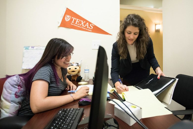 (From left) Aurora Ibarra, RAICES legal assistant, and Katie Mullins, RAICES staff attorney, discuss notes in the office.