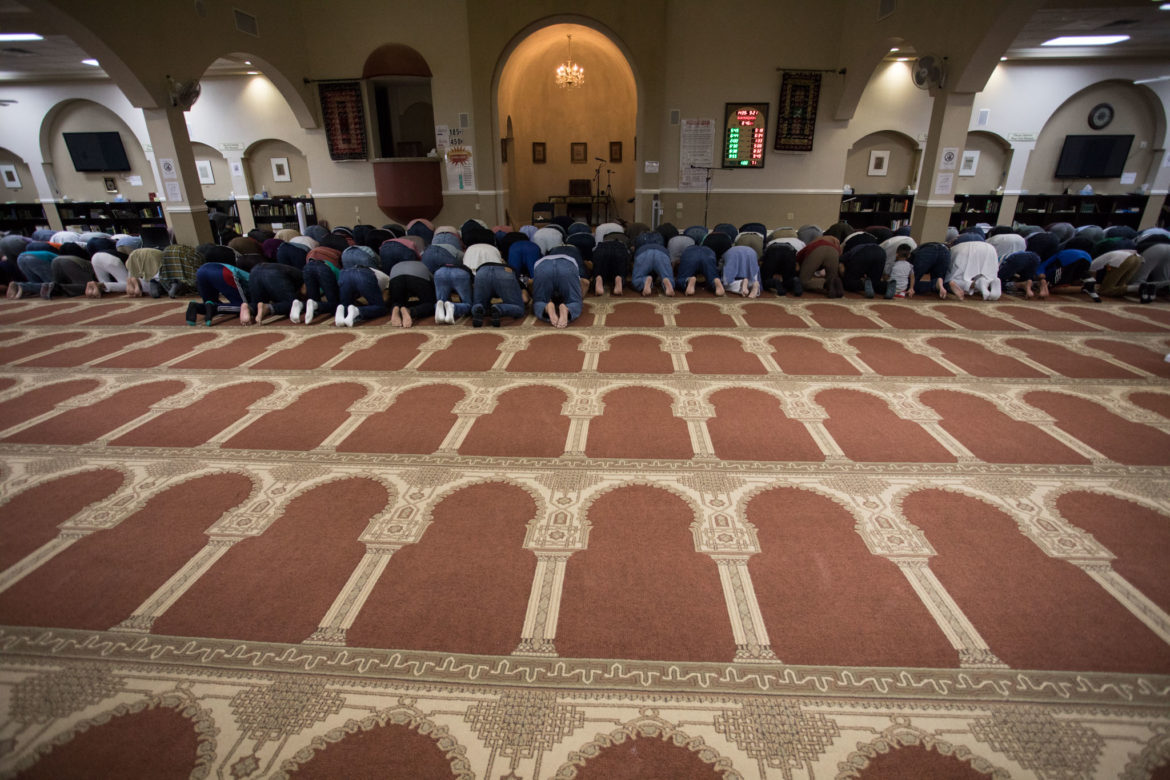 Men prostrate on the floor for the Maghreb prayer, which is held every day at sunset.