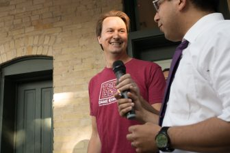 (From left) Tech Bloc CEO David Heard hands the microphone to State Rep. Diego Bernal (D-San Antonio).