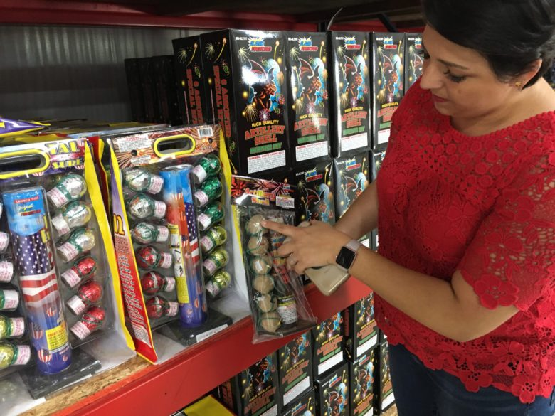 Alamo Fireworks' Celina Montoya demonstrates reloadable tube fireworks.