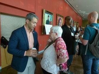 Mayor Ron Nirenberg (left) speaks to Gabriella Lohan, a COPS/Metro Alliance member, before the program begins.