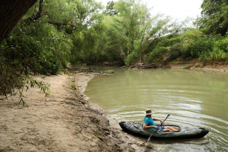 The Trailist Brendan Gibbon launches along the muddy banks of the San Antonio River.