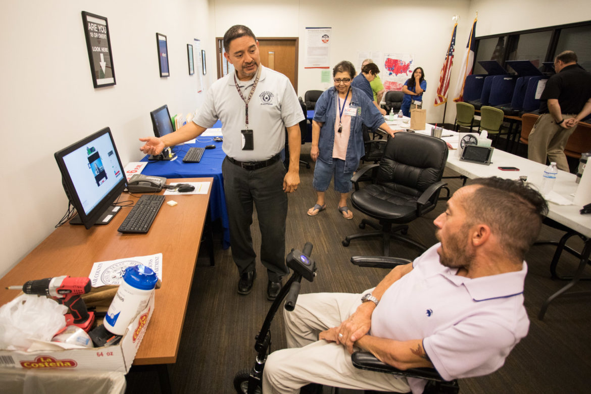 Adam Flores-Boffa examines the Election Department's software available for people who prefer the ballot in American Sign Language.