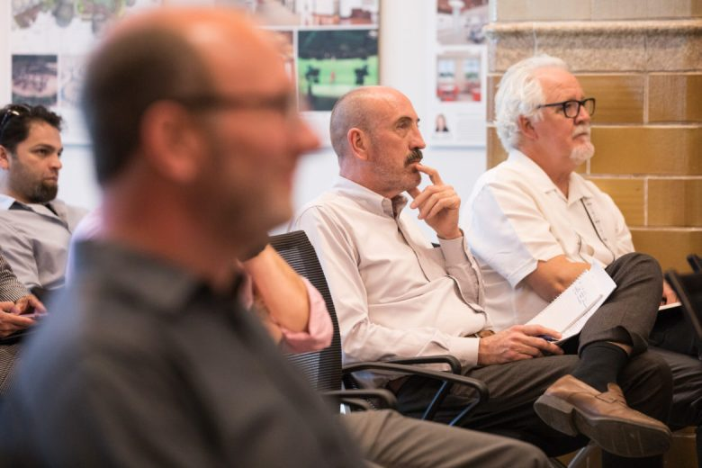 Irby Hightower, Alamo Architects Founding Principal, listens to the presentation.