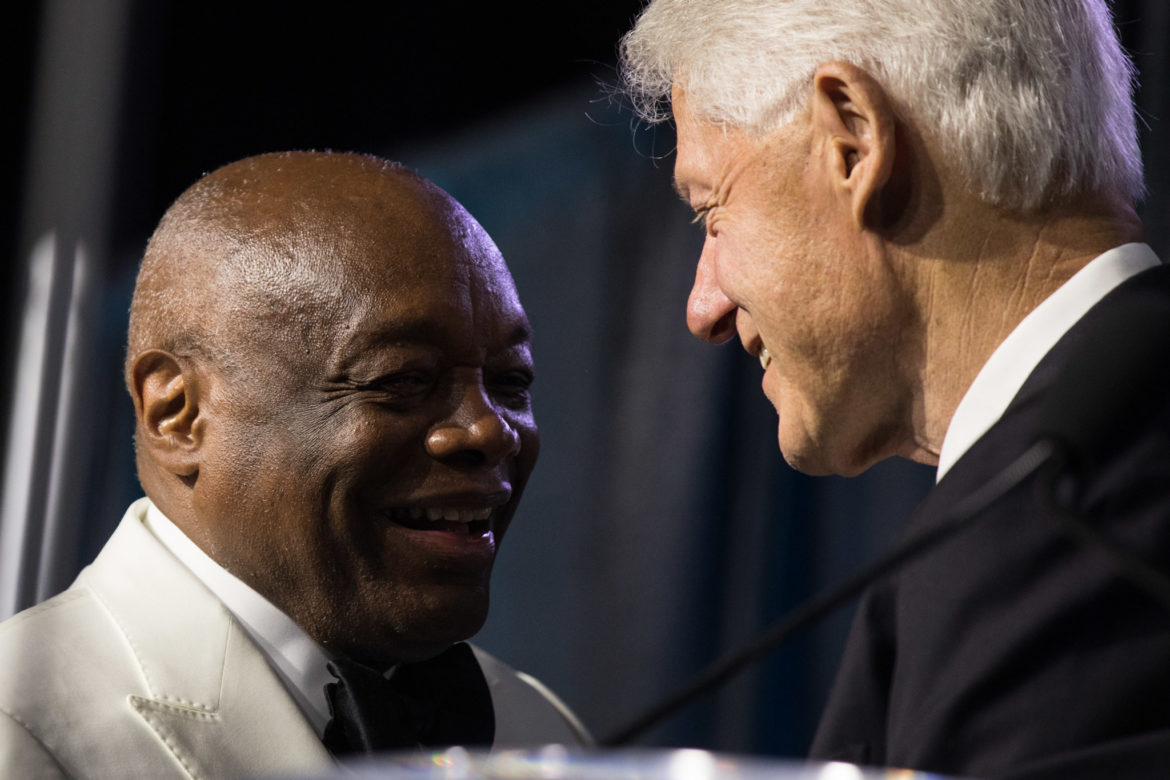Former President Bill Clinton (right) introduces former San Francisco Mayor and California Assembly Speaker Willie Brown Jr. as the 2018 recipient of the Spingarn Medal.