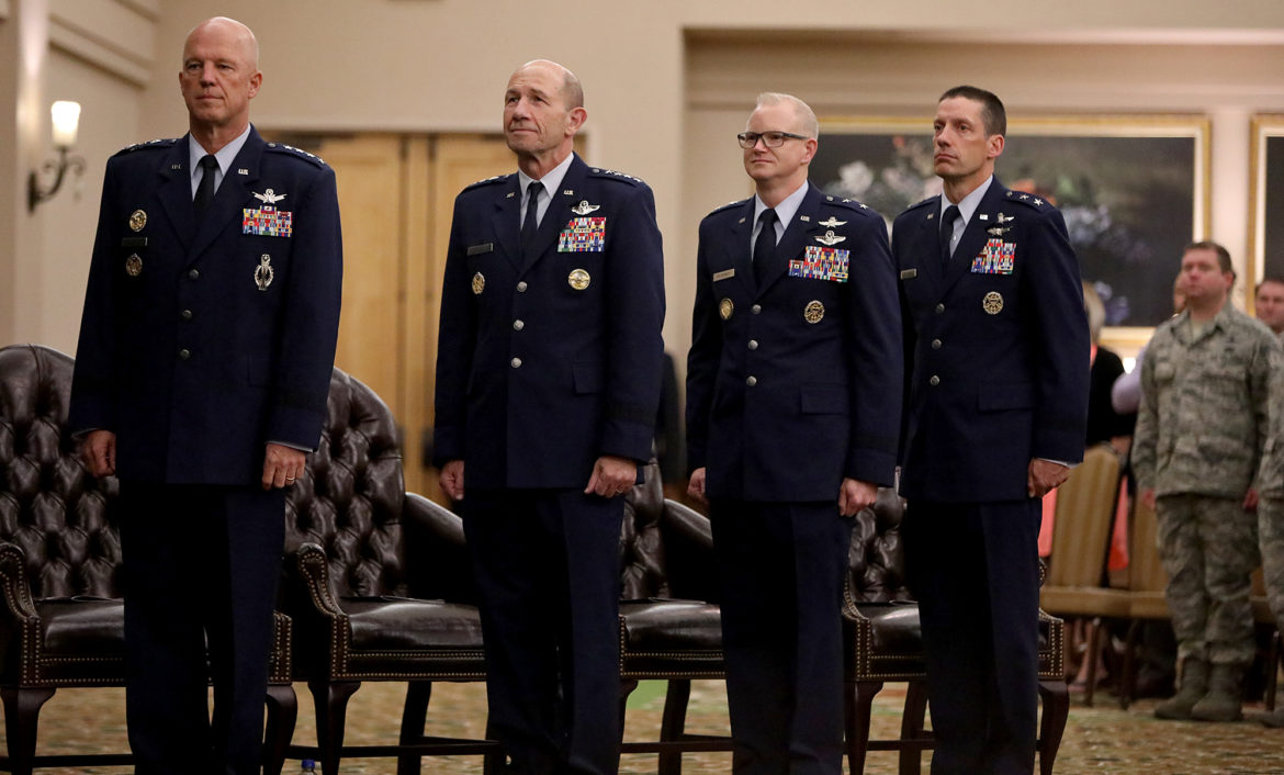 """Gen. John W. """"Jay"""" Raymond, Commander of Air Force Space Command, (from left), Gen. James M. """"Mike"""" Holmes, Commander of Air Combat Command, Maj. Gen. Christopher P. Weggeman, outgoing Commander of 24th Air Force and Maj. Gen. Robert J. Skinner, incoming Commander of 24th Air Force, stand during the 24th Air Force Command Reassignment and Change of Command Ceremony held Tuesday July 17, 2018 at Joint Base San Antonio-Lackland."""