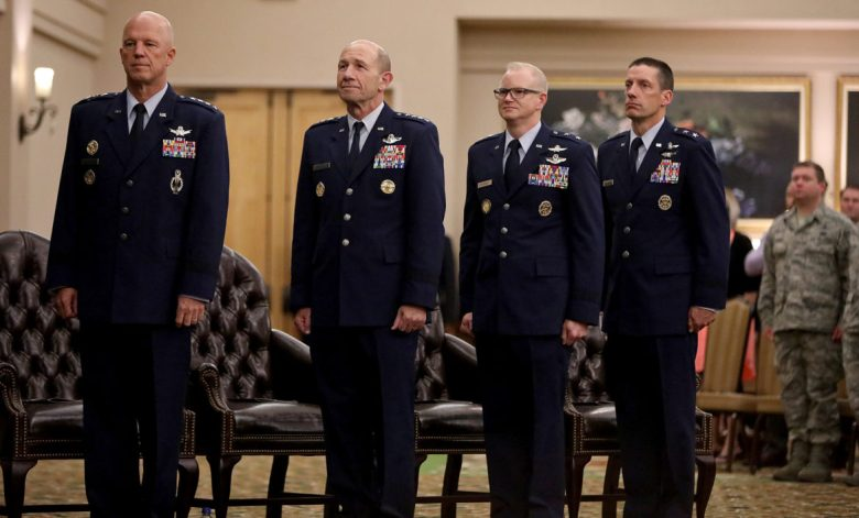 "Gen. John W. ""Jay"" Raymond, Commander of Air Force Space Command, (from left), Gen. James M. ""Mike"" Holmes, Commander of Air Combat Command, Maj. Gen. Christopher P. Weggeman, outgoing Commander of 24th Air Force and Maj. Gen. Robert J. Skinner, incoming Commander of 24th Air Force, stand during the 24th Air Force Command Reassignment and Change of Command Ceremony held Tuesday July 17, 2018 at Joint Base San Antonio-Lackland."