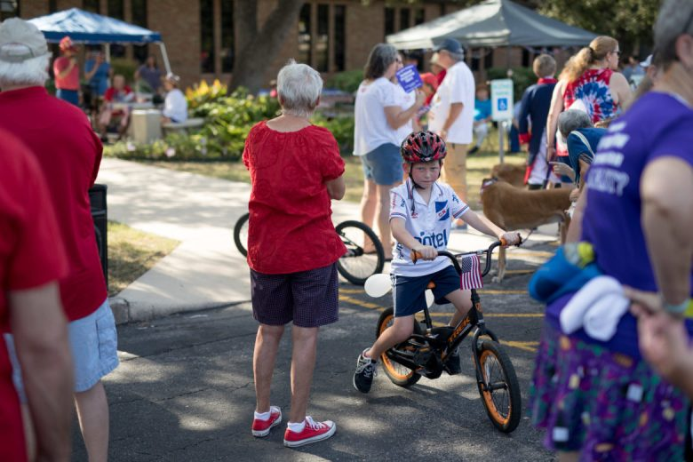 Neighborhood kids ride bikes through the Oak Park and Northwood 4th of July Parade.