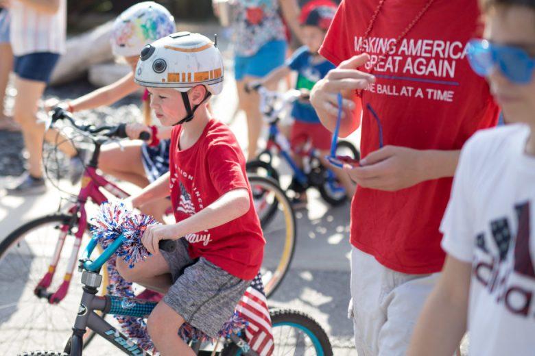 Children ride bikes through the parade route.