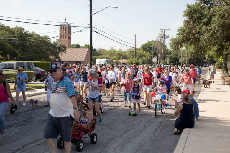 Over 150 residents from the Oak Park and Northwood neighborhoods walk in the annual 4th of July Parade.