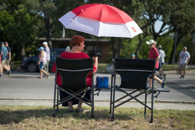 Neighborhood resident Jan Steuart watches as the parade passes by.