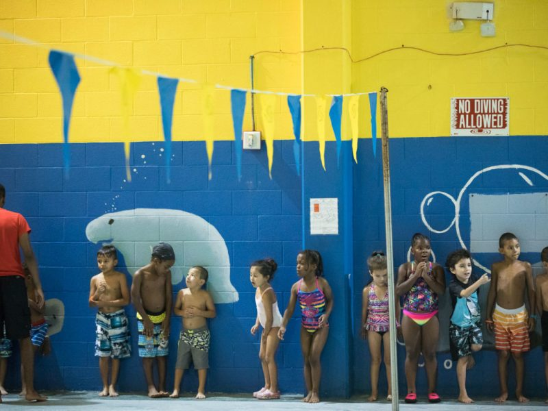The seahorse group stands in a line near the Boys and Girls Club swimming pool in the city's Westside.