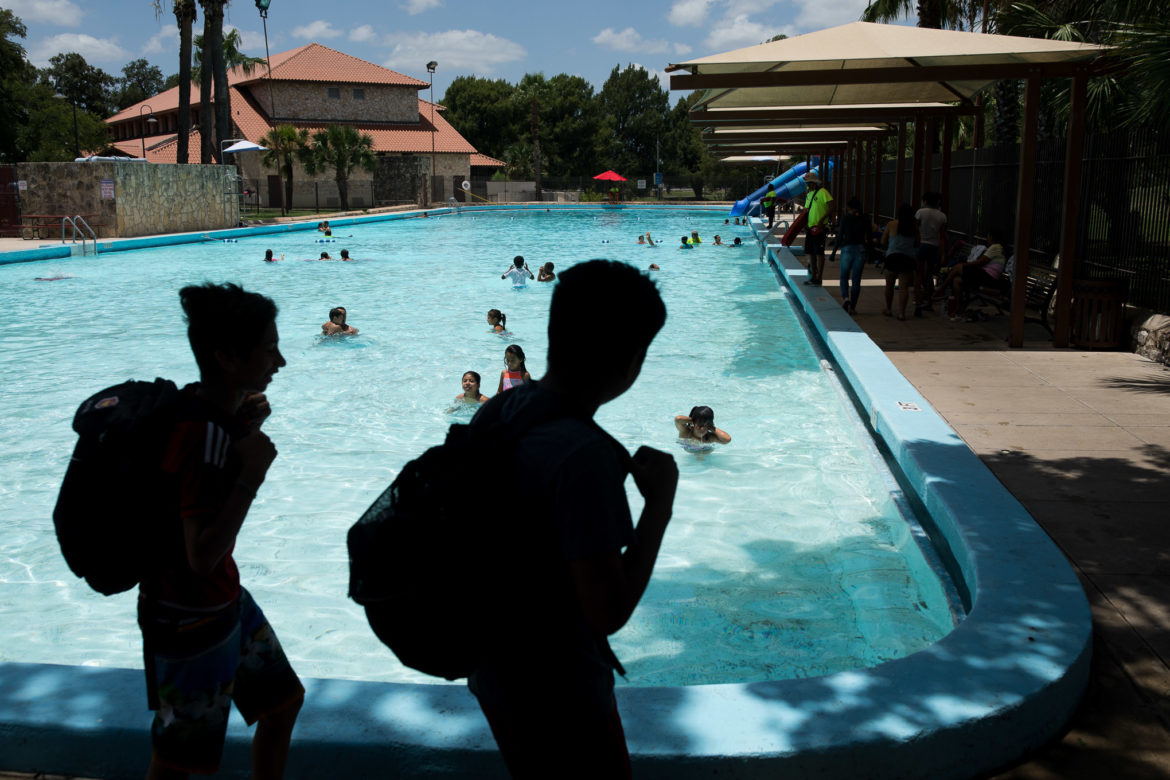 Eager swimmers arrive to Woodlawn Lake Pool.