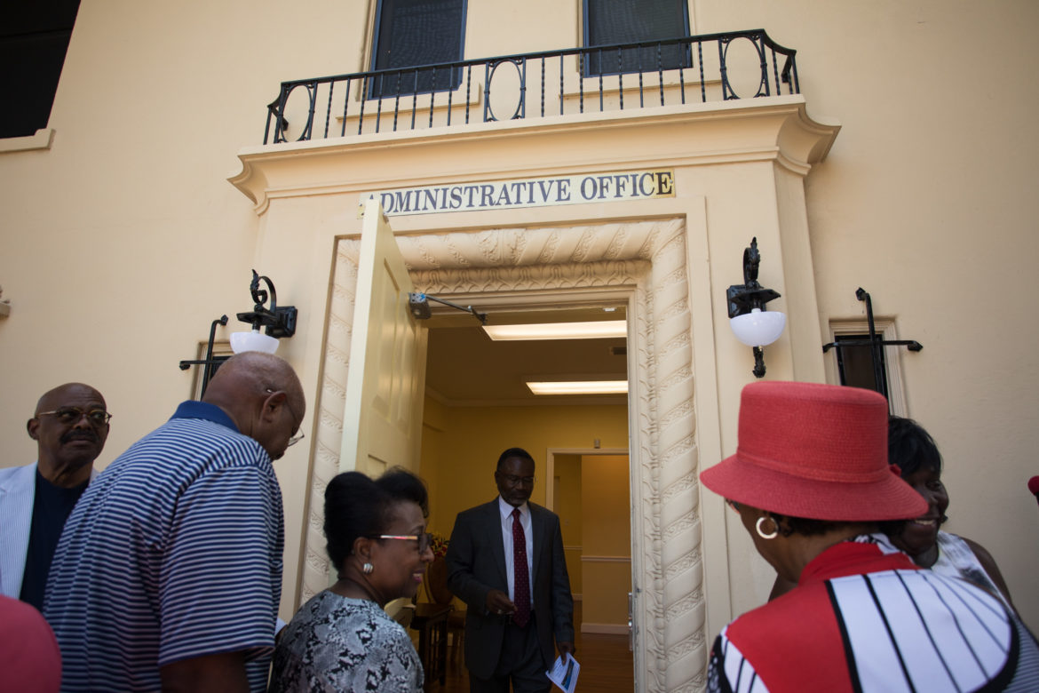 Members of the Greater Corinth Baptist Church prepare for a tour of Bellinger Mansion.
