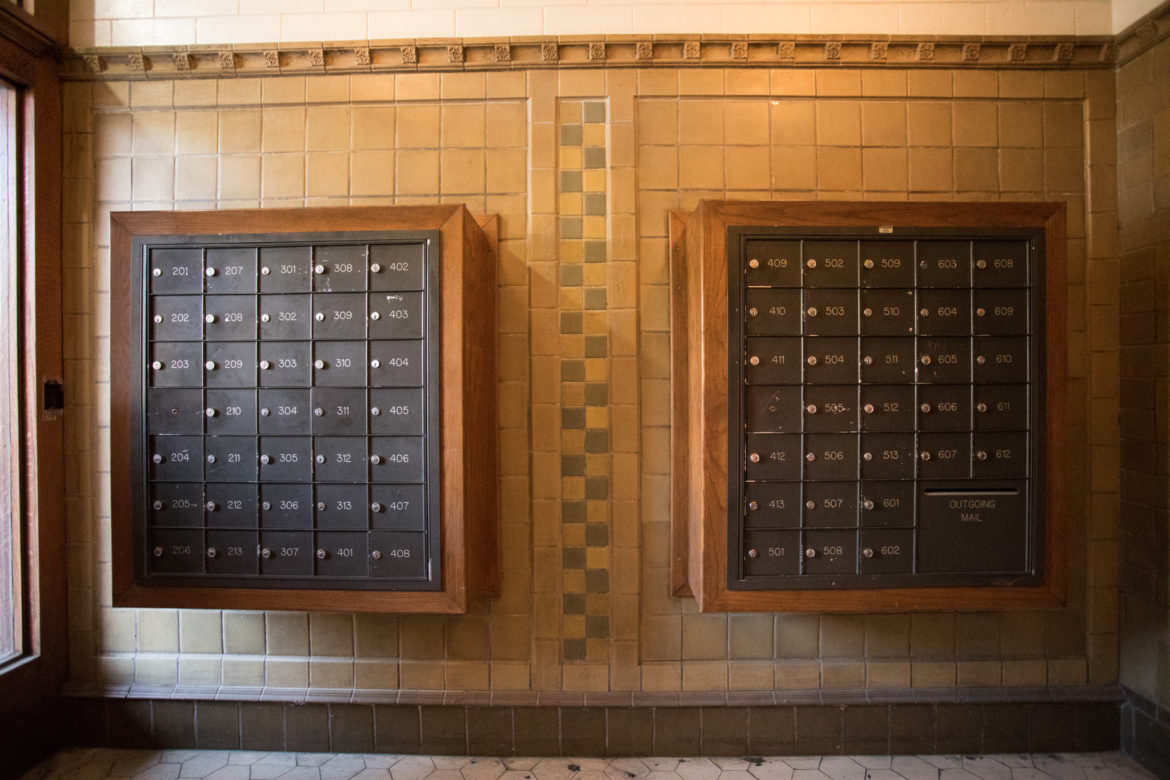 Mailboxes line the entryway to the lobby of Calcasieu Apartments.