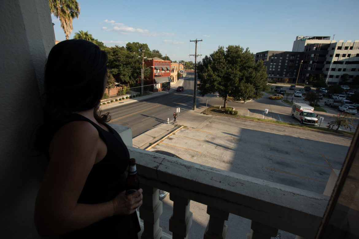 Lori McCorquodale Todd, Hermann Sons Life Home Association board member, looks out from a ballroom balcony on to St. Mary's St.