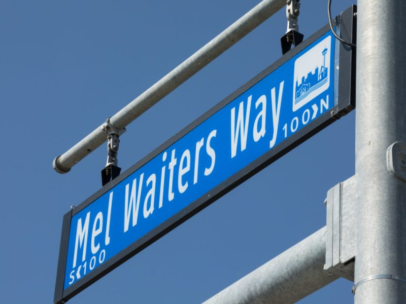 The Mel Waiters Way sign hangs at the intersection with Commerce Street.