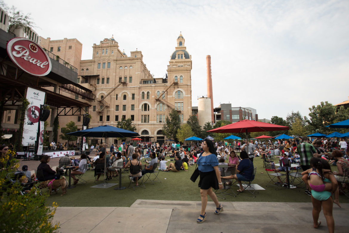 A large crowd forms at the Pearl before the Olé San Antonio festival on August 3, 2018.