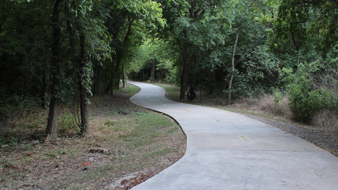 A concrete path that's part of Salado Creek Greenway - South, a 7.2-mile section of trail on San Antonio's East Side.
