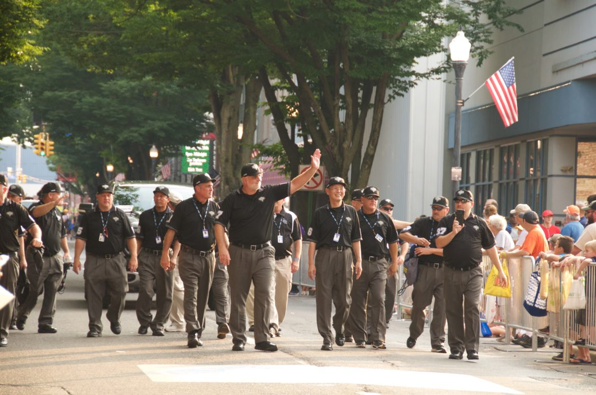 Little League World Series Umpires led by Gary Panozzo walk through the streets of Williamsport, Pennsylvania.