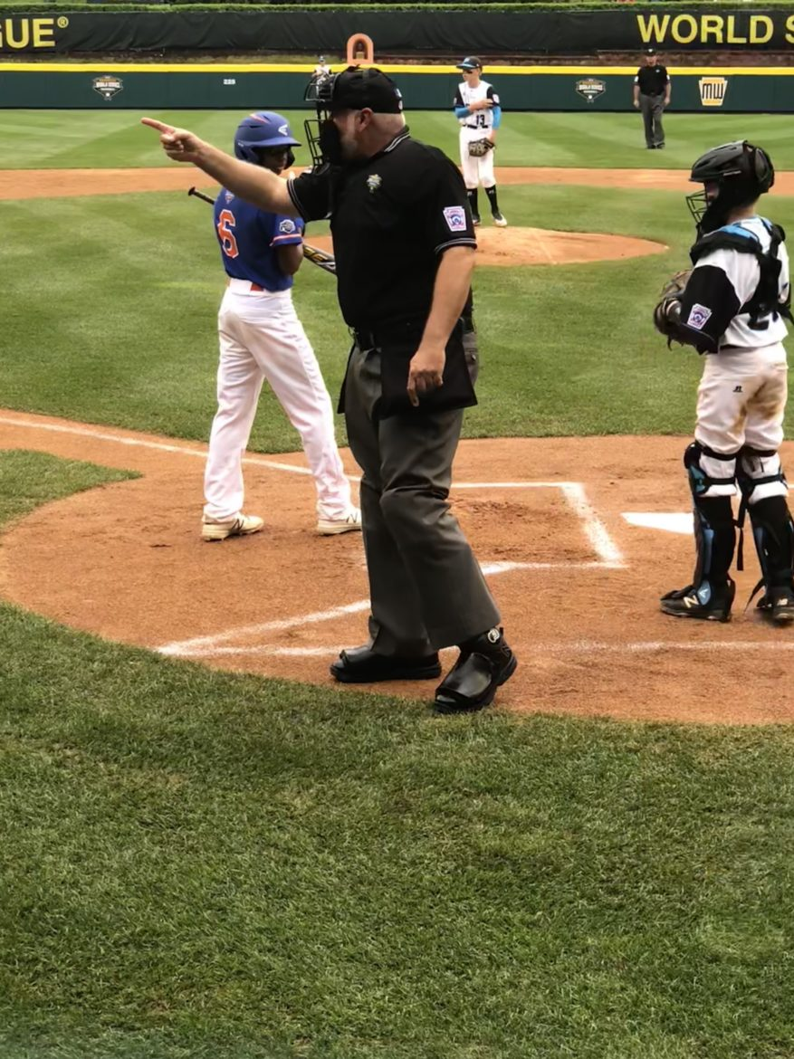 Gary Panozzo covers home plate during the Little League World Series.