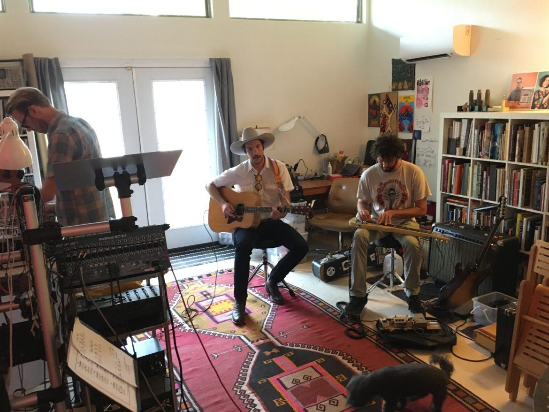 Garrett T. Capps along with Justin Boyd (left) and steel guitarist Toren Metz.