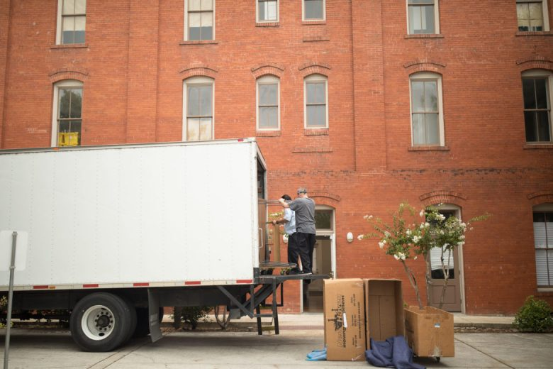Movers unload Rivard Report staff desks at 126 Gonzales Street in St. Paul Square.