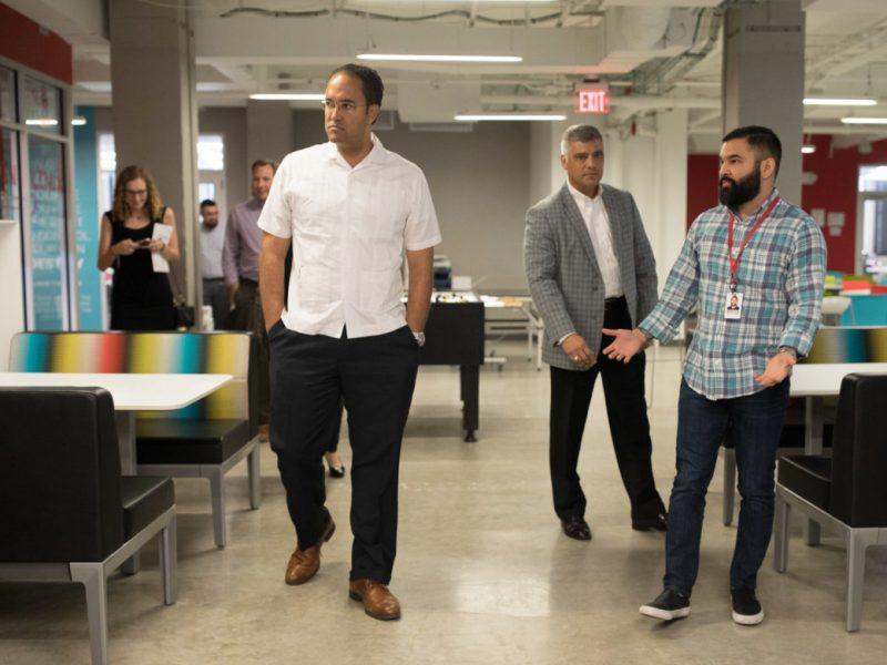 Congressman Will Hurd (R-Texas) walks through the Rackspace Open Cloud Academy during a tour of the tech education bootcamp.
