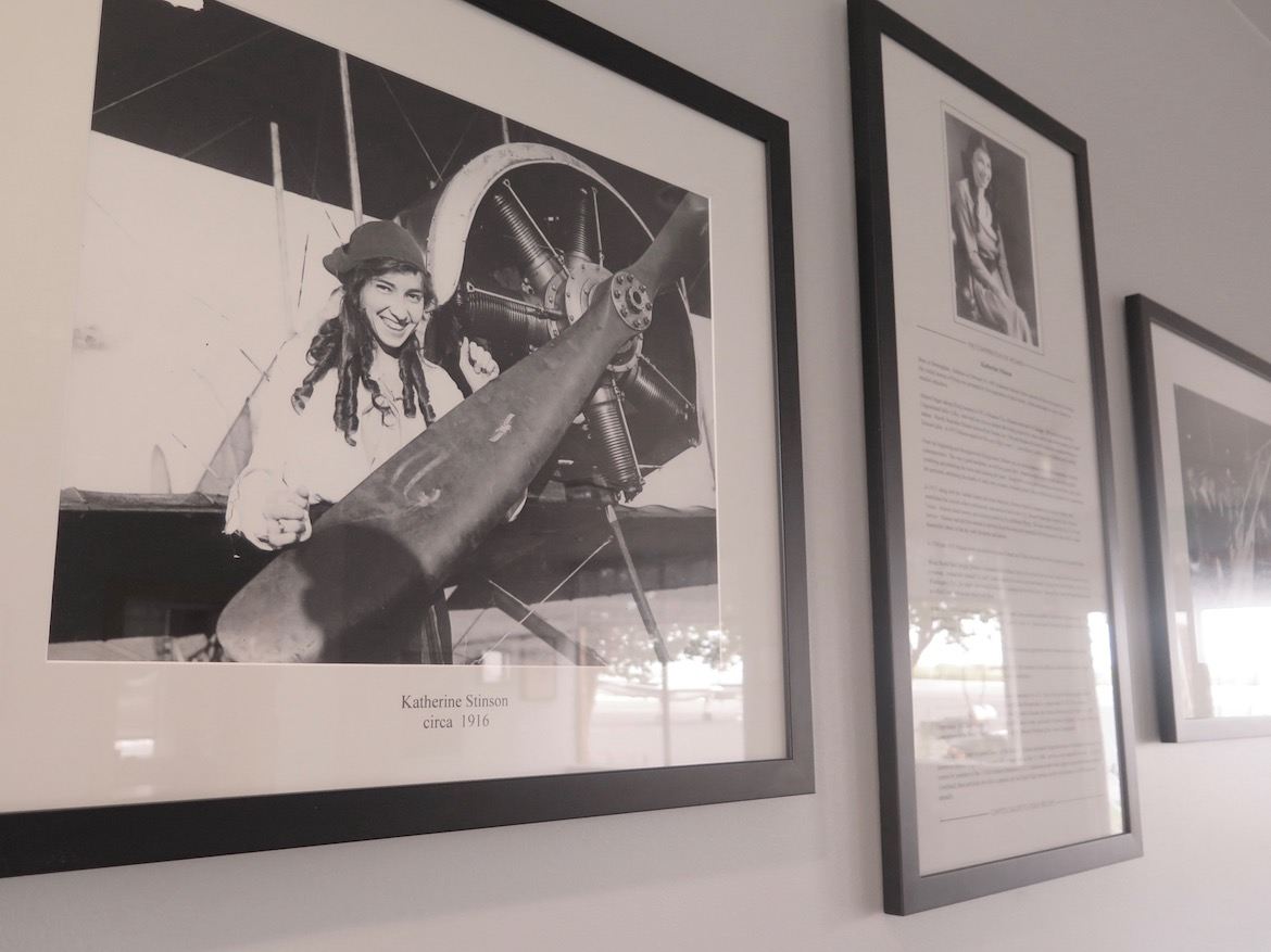 Photos of and information about Marjorie, Katherine and Eddie Stinson line the walls of Stinson Airport's lobby.