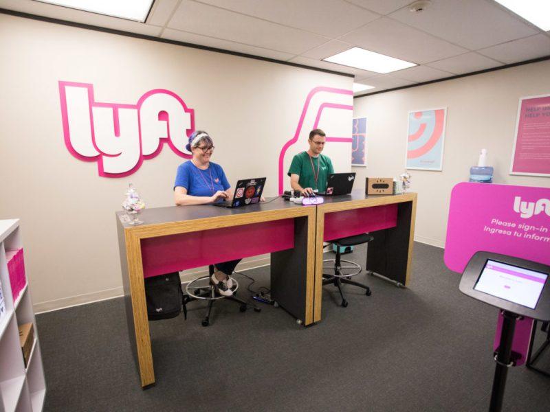 (From left) Lyft community associates Debbie Mcdiarmid and Ryan Hengtgen welcome drivers to the Lyft Driver Support Center.