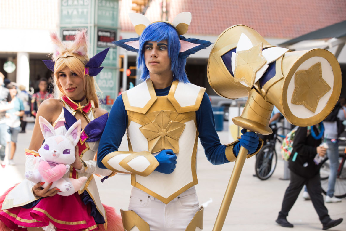 Ahri and Poppy from League of the Legends walk into the Henry B. Gonzalez Convention Center.