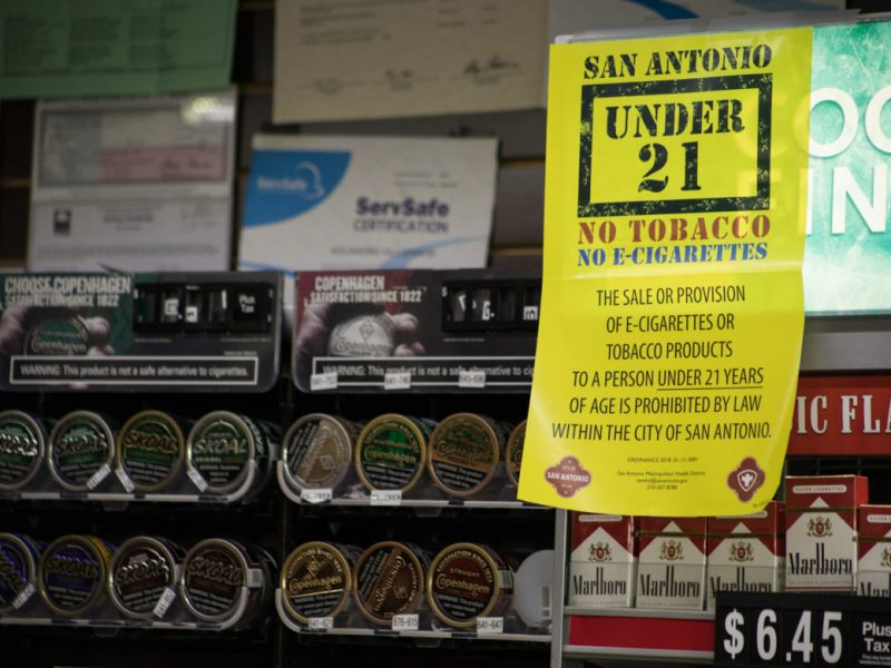 A sign at Molina's San Antonio Country Store indicates that tobacco products cannot be sold to a person under twenty-one years old.