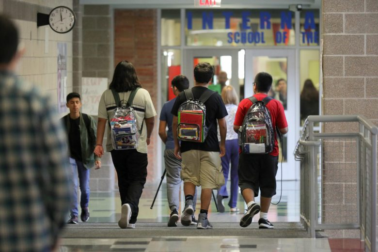 Students wear clear backpacks through the halls of LEE High School.