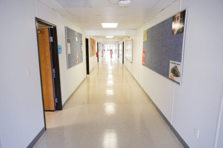 A child walks through the halls of the School for Science and Technology on Culebra Road.