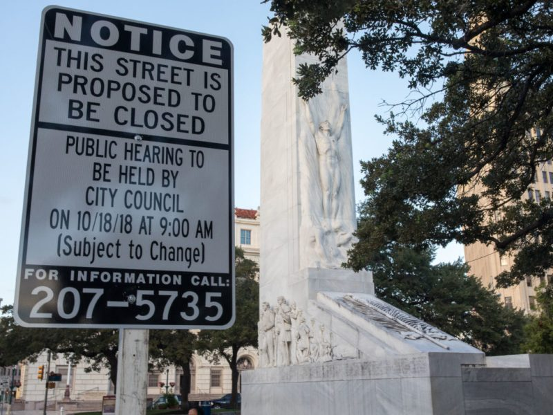 A sign informing the public of the proposal of Alamo Street along Alamo Plaza to be closed permanently.