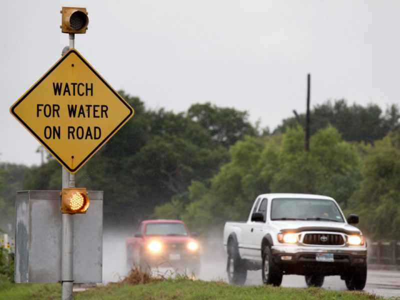 A sign warning drivers of water on Austin Highway.