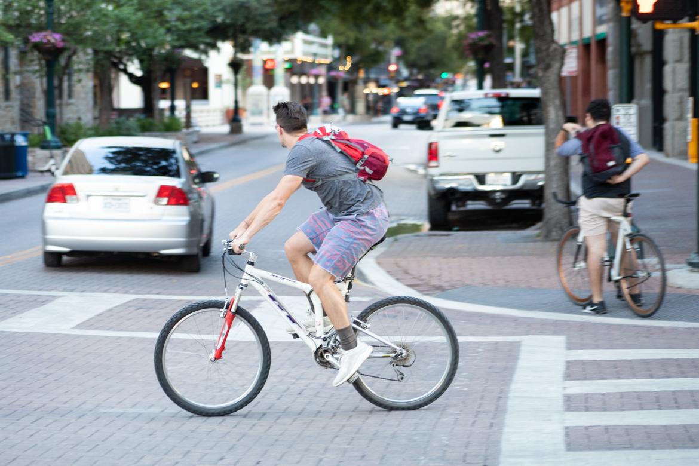 A cyclist crosses East Houston Street on Soledad Street.