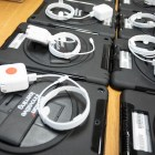 iPads and chargers are lined up to give to Harris Academy students.