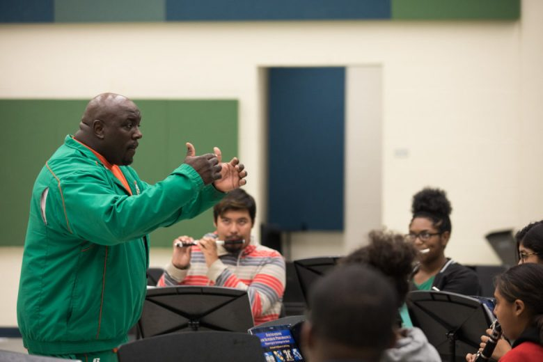 Sam Houston High School Director of Bands Bruce Adams leads a rehearsal after school.