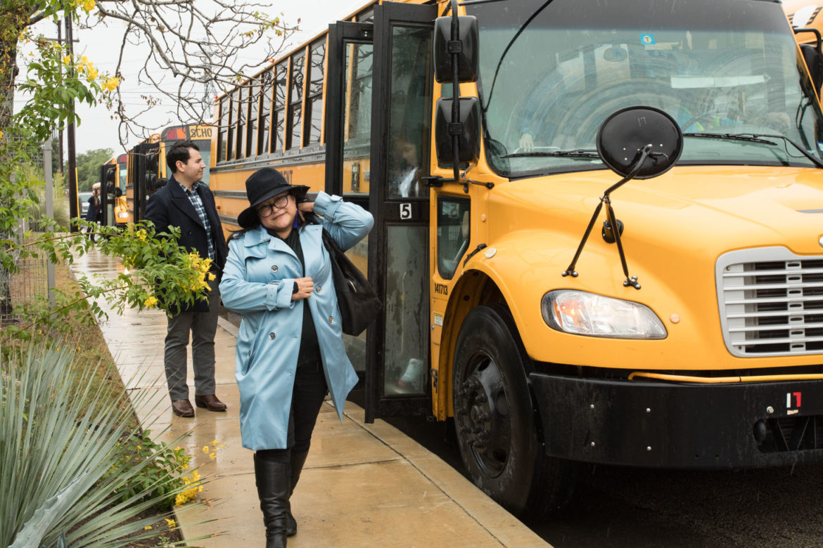 Erika Prosper exits a school bus with seniors from KIPP University Preparatory High School at Bexar County Election Office to participate in early voting.
