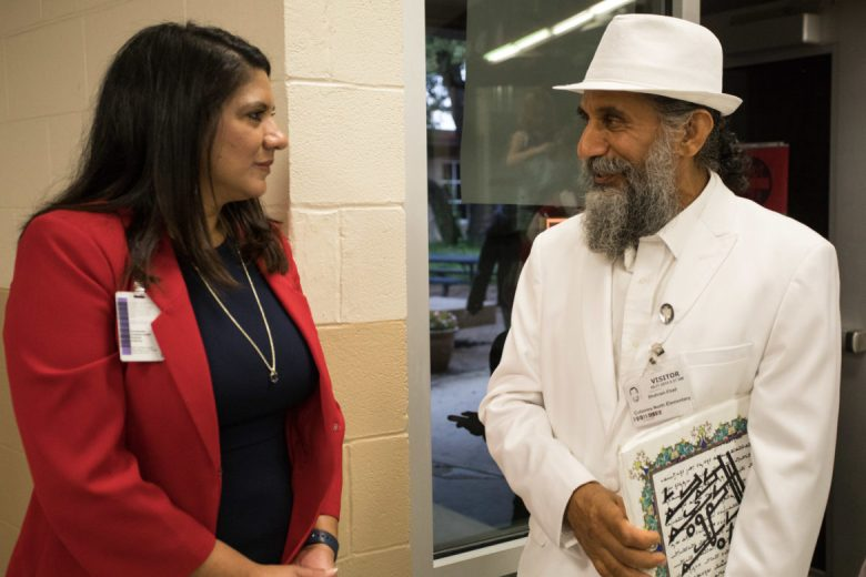 Colonies North Elementary School principal Norma Farrell speaks with Shahram Ebad Fard Zadeh after the program.