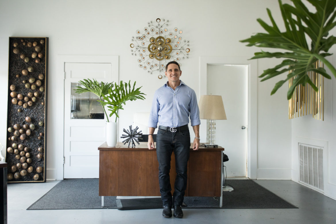 Kevin Elkins, owner of Soular Therapy, stands in the front office.