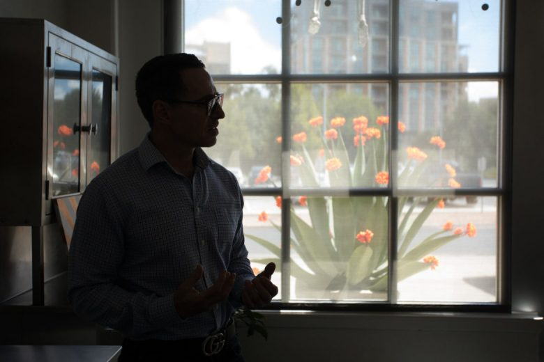 Kevin Elkins is silhouetted in the front office of Soular Therapy.