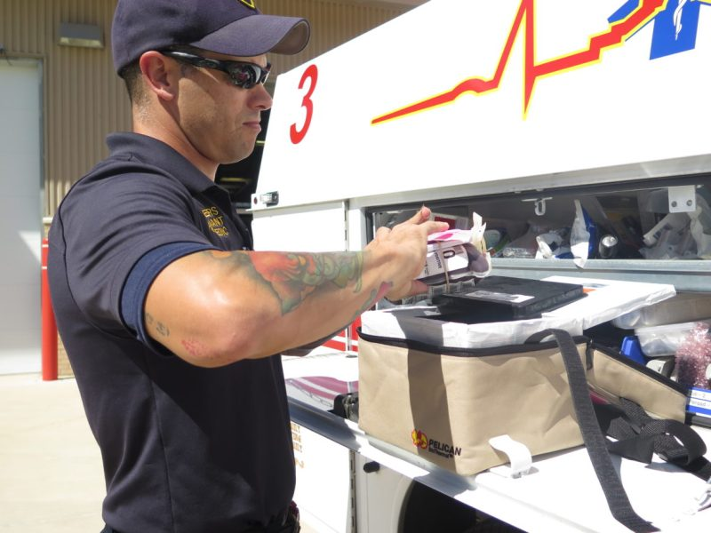 SAFD Paramedic Matt Bowers removes whole blood from a cooler that can keep it cold for up to 50 hours.