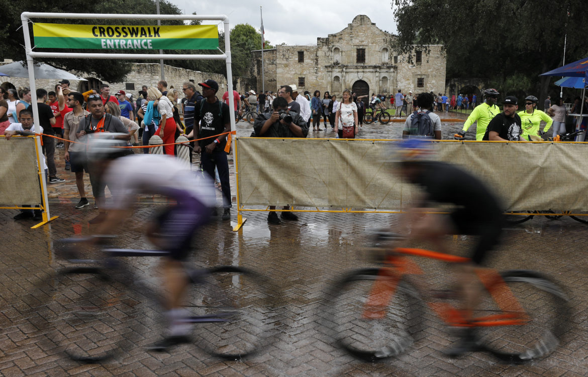 Riders pass the Alamo in qualifying heat during the Red Bull Last Stand held Saturday Oct. 13, 2018 in Alamo Plaza.