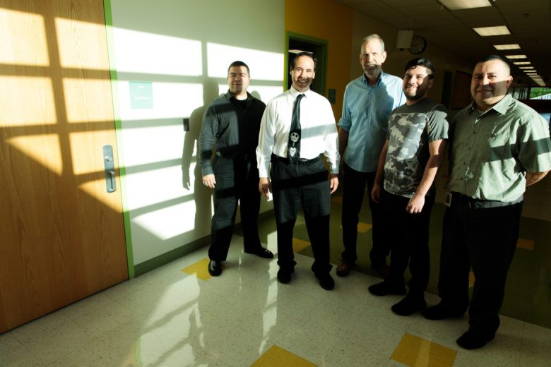 Music Teacher Paul Parrea (second from left) is flanked by fellow male educators teaching at Arnold Elementary School.