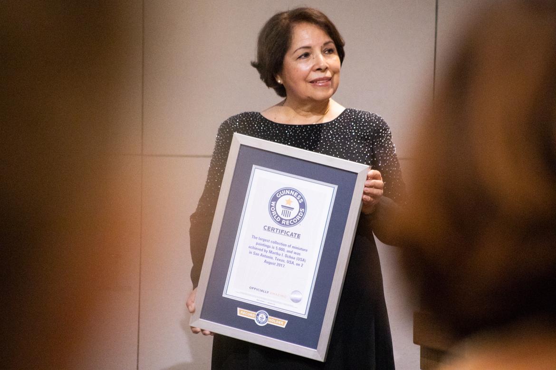 Martha Ochoa Olazo receives the official certificate.