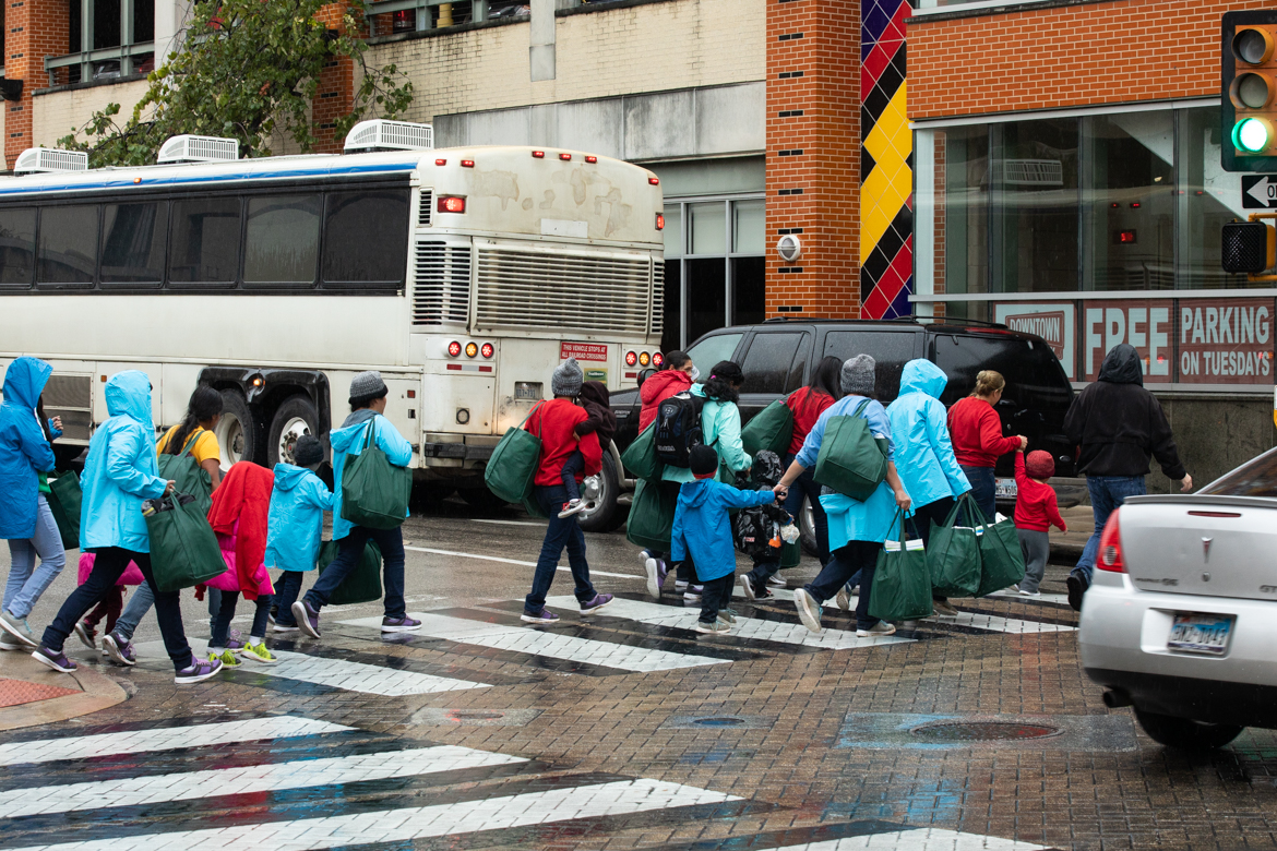Women and children who just arrived from Dilley Detention Center walk from San Antonio's Greyhound bus station to Travis Park United Methodist Church in October 2018.