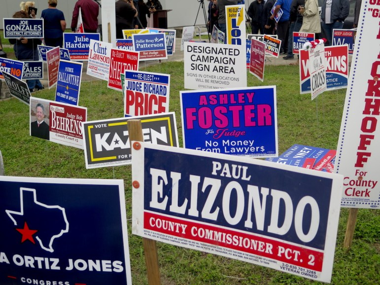 The lawn outside Las Palmas Public Library is covered with campaign signs on Oct. 22, 2018, the first day of early voting for the midterm election.